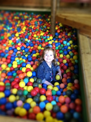 A huge indoor ball pit with slides, jump platforms...