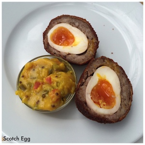 The Scotch Egg is a typical appetizer at pubs. It's a soft boiled egg, encased in sausage, battered and fried. Served with relish mustard. We liked it fine, but it wasn't a fav.