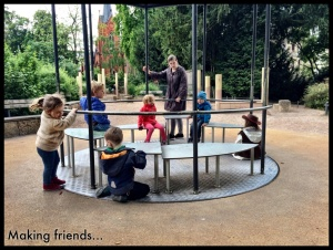 We love the merry-go-rounds here- how they're built into the ground. We love them even more when we can play on them with friends :)