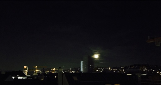 Full moon over the city, view from our patio...